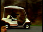 President Ronald Reagan erratically drives golf buggy to meet Prime Minister Margaret Thatcher arriving in helicopter Camp David 15 Nov 86