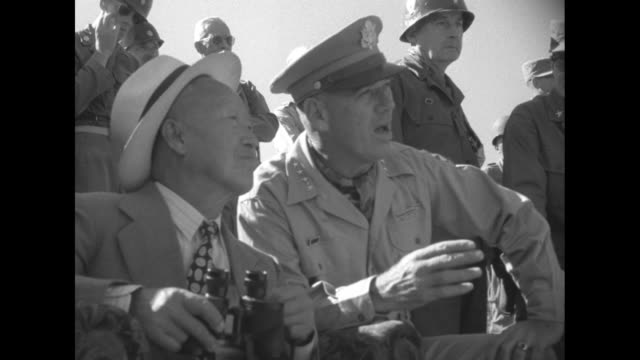 President Syngman Rhee and Gen James Van Fleet Commander of US Eighth Army and United Nations Forces in Korea standing with group of ROK and US...