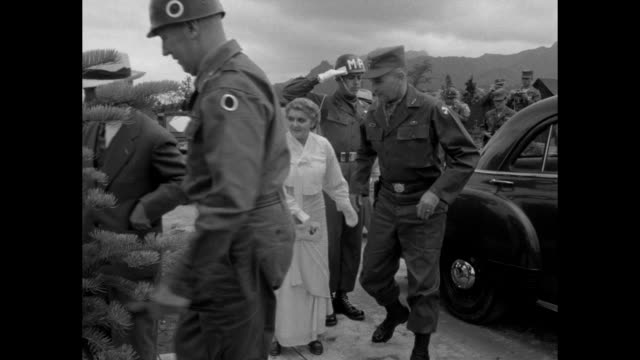 President Syngman Rhee at microphone / Rhee wife Francesca Donner Rhee arrive at military base greeted by commander of Eighth United States Army...