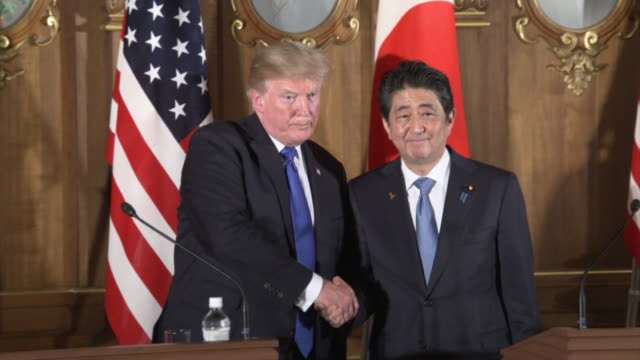 "President Trump and Prime Minister Abe attended JapanUS joint press conference Camera zooming into Abe Abe saying ""Japan needs to expand its defense..."