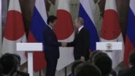 President Vladimir Putin on Thursday agreed to start flights for former residents to visit a disputed island chain as he and Japanese premier Shinzo...