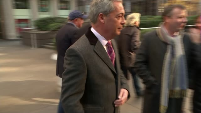 US Presidentelect Donald Trump meets Nigel Farage / Trump '60 Minutes' interview USA New York New York EXT Nigel Farage MEP shaking hands with woman...