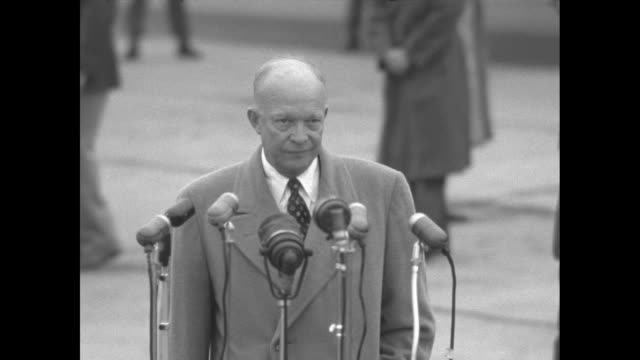 US Presidentelect Dwight Eisenhower steps up to microphones on tarmac and speaks then walks away