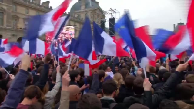 Presidentelect Emmanuel Macron faces challenge of building Parliamentary majority The Louvre Various shots Macron supporters cheering and celebrating...