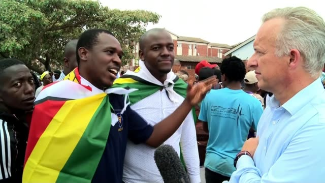 Presidentelect Emmerson Mnangagwa arrives in Harare Vox pops with ITN Reporter in shot