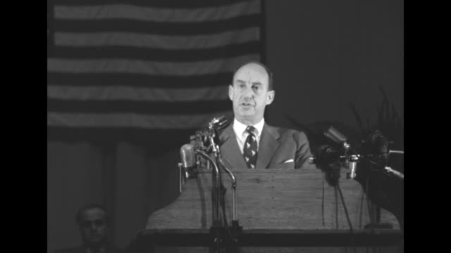 VS US presidential candidate Adlai Stevenson speaks from stage of arena to packed crowd of enthusiastic supporters in Seattle