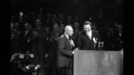 Presidential candidate Dwight D Eisenhower quickly walks to podium and greets Sen Henry Cabot Lodge Jr / cheering crowd / Mamie and Dwight Eisenhower...