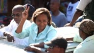 Presidential candidate from Lavalas Political Party Marysse Narcisse accompanies former President Jean Bertrand Aristide to greet supporters during a...