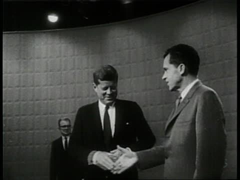 Presidential candidates Senator John F Kennedy and Senator Richard Nixon shake hands before a televised debate