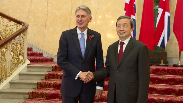 Future of trade relationship between UK and US ENGLAND London ***BEWARE Philip Hammond MP shaking hands with Ma Kai at photocall