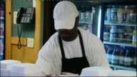 Obama wins new first family Chicago McCarthy's Diner INT Two black men sitting eating at table Staff working at counter Staff member putting food in...