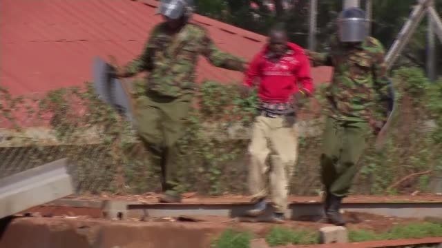 Ballots counted Kibera Various of roads through shanty town as car along TRACK EXT Riot police along street View over rooftops of the shanty town as...