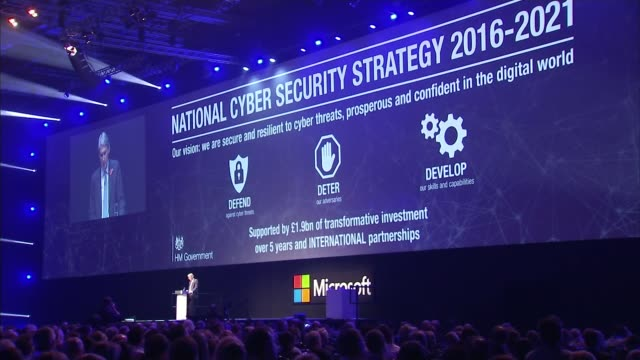 Russian hackers 'linked' to Democrat stolen emails ENGLAND London INT Wide shot of Philip Hammond MP giving speech on National Cyber Security...