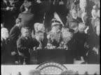 Presidential motorcade Washington DC street / Paramount News announcer speaks / House Speaker Sam Rayburn and Senate Leader Alben W Barkely ride with...