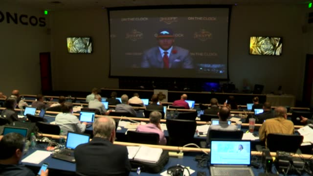 Press coverage and press conference Denver Broncos NFL draft first round pick at the team's headquarters in Dove Valley / General manager John Elway...
