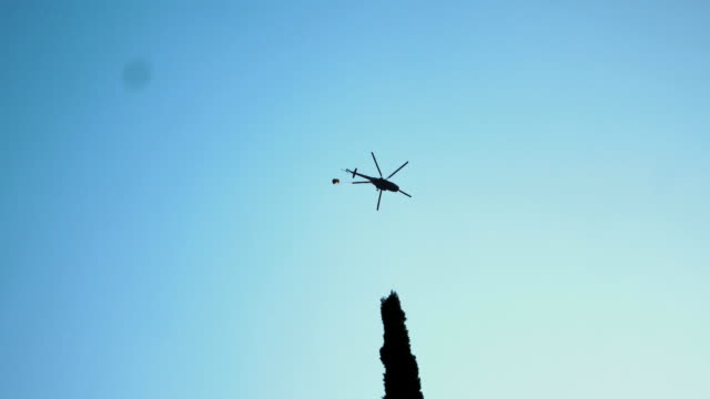 Press helicopter flying above city