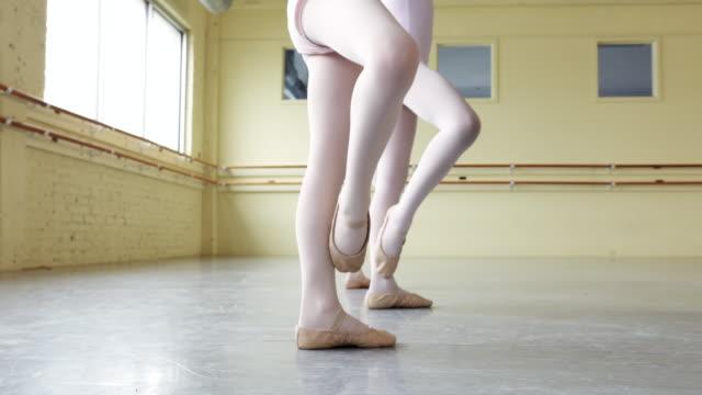 Preteen ballerinas practicing form
