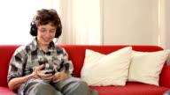 Pre-teen boy listening to  an mp3 player