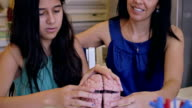 Preteen student assembling model of human brain during home school science class