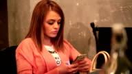 Pretty brunette enjoying coffee in cafe