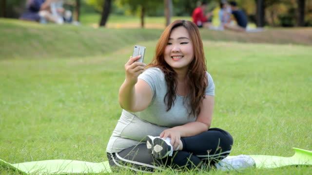 Pretty fat female takes travel selfie
