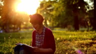 Pretty girl reading book in the park