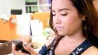 Pretty woman use smart phone in Salon