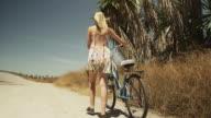 Pretty woman walking with bike
