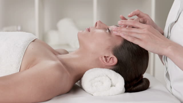 HD DOLLY: Pretty Young Woman Enjoying Facial Massage