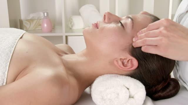HD CRANE: Pretty Young Woman Getting Facial Massage