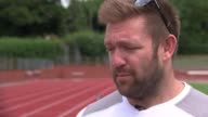 Preview of World Para Athletics championships in London ENGLAND EXT Dan Greaves set up shot with reporter / interview SOT Kylie Grimes Grimes holding...