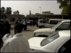 Prewar Iraq / WS Crowd scene / MS Republican Guard officers in uniform / MS Iraqi men giving peace sign to camera / Iraq / AUDIO