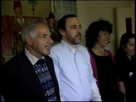 Prewar Iraq / WS MS Iraqi family welcomes Pink activists into home for meal / Iraq / AUDIO