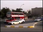 Prewar Iraq / LA Saddam Hussein statue / WS Street scenes / Iraq