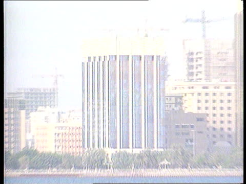 Price Waterhouse report released ABU DHABI GV Skyline seen across water ZOOM GV Office building LA GV Ditto TILT DOWN 'BCCI Main Branch' sign NAT