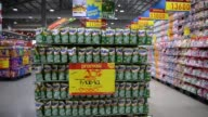 Prices hang beside advertising inside a Hypermart supermarket operated by PT Matahari Putra Prima in Jakarta Indonesia on Friday Jan 23 Tilt down...