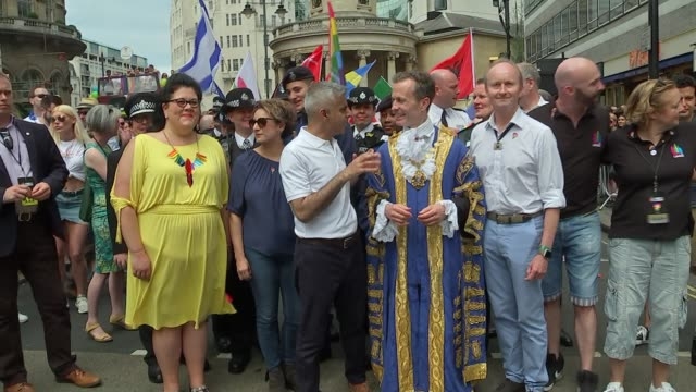 Pride march GVs and interviews Justine Greening MP standing with Councillor Ian Adams and members of the emergency services at the head of the march...