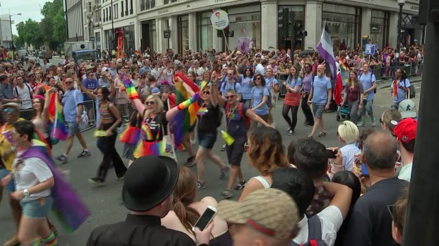 Pride march GVs and interviews Various of pride parade marchers along Oxford Street to Regent Street and vox pops SOT