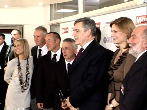 Arrivals and interviews Prime Minister Gordon Brown MP wife Sarah and members of the Torbay RNLI Lifeboat Crew posing for photocall