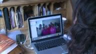 Local fundraiser award Holly Bantleman ENGLAND Surrey Chertsey Variou shots Holly Bantleman greeting people in Kenya through internet link on tablet...