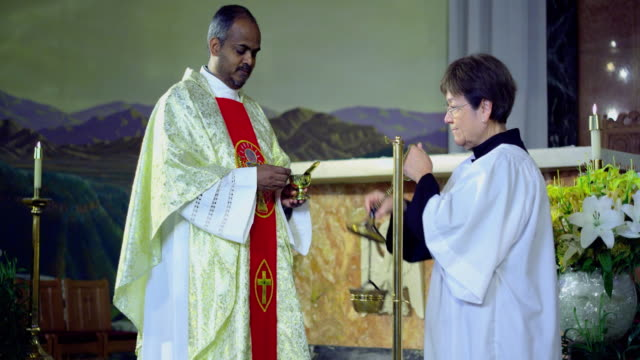 MS Priest blessing altar with incense, Manhattan Beach, California, USA