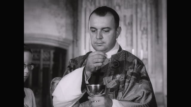 MS Priest giving communion in church / United States