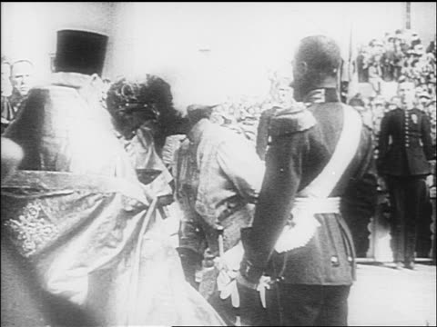 B/W 1918 priest kissing Czarina's hand as Czar looks on / documentary
