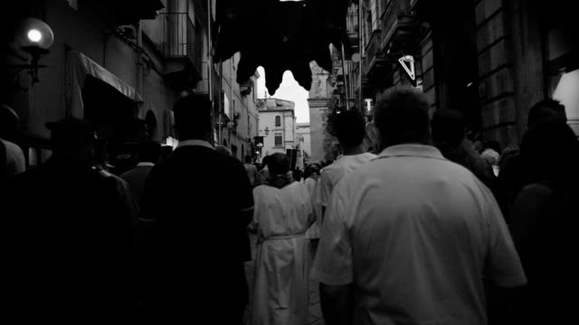 A priest on the procession in the streets of Catania