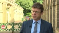 Prime Minister accused of backing down over corporate pay London EXT Greg Clark MP interview SOT