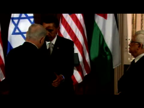 Prime Minister Barack Obama walks towards and shakes hands with both Prime Minister Netanyahu and President Abbas New York 22 September 2009