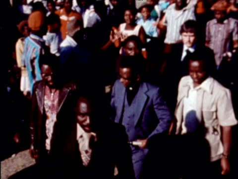 Prime Minister Bishop Abel Muzorewa arrives to large crowd of supporters 1970s