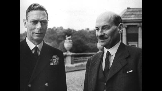 VS Prime Minister Clement Attlee and King George VI walk and talk on grounds near palace / Note exact day not known / [Note film has nitrate...