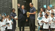 Prime Minister David Cameron welcomes the Webb Ellis Cup to Number 10 Downing Street the day before the start of the Rugby World Cup Shows David...