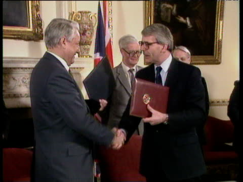 Prime Minister John Major and President Boris Yeltsin stand up and shake hands after signing joint declaration of friendship which they exchange 10...